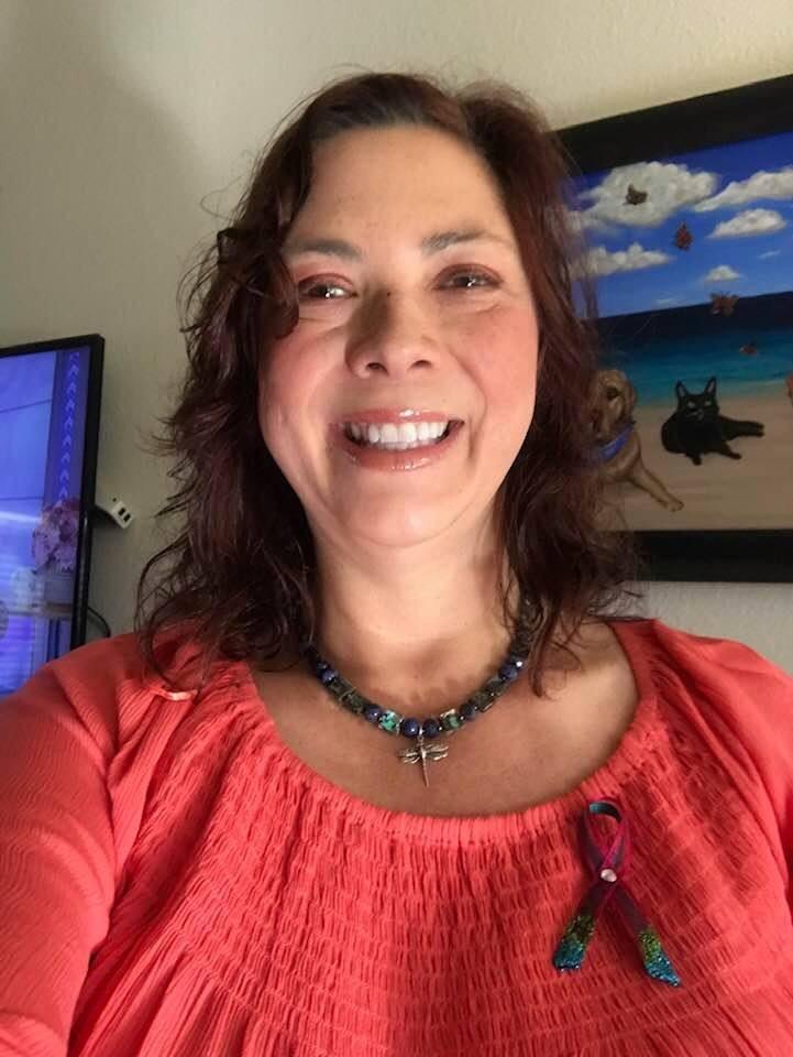 Andrea wearing her MOG awareness ribbon