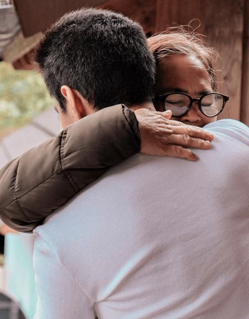 Francis's mom hugging him